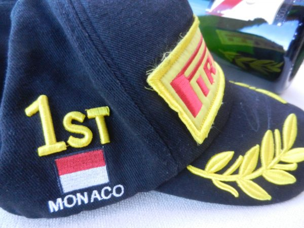 Mark Webber Podium Cap Worn by Mark After Winning the 2012 Monaco Grand Prix in the Red Bull.