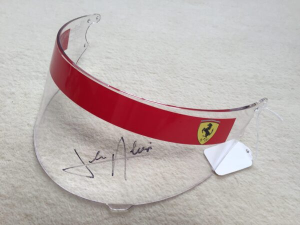 This is a genuine but unused Shoei GRV visor from 1991, as used and hand signed by Jean Alesi.
